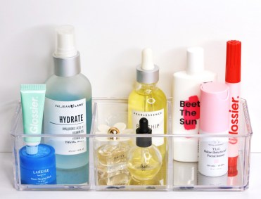 How to use hyaluronic acid in your skincare routine | Hyaluronic Acid for Dry Skin | Hyaluronic Acid Anti-Aging benefits | Hyaluronic Acid Toner | Valjean Labs Hydrate Toner Mist | Skincare shelfie | Skincare aesthetics | Valjean Labs Hydrate Mist featured on left. Other featured products from left to right: Glossier Balm Dot Com, Laneige Water Sleeping Mask, Marc Jacobs Daisy, Pearlessence Rosehip Seed Oil, Fur Oil, Krave Beauty Beat the Sun, Drunk Elephant Babyfacial, Glossier Zit Stick.