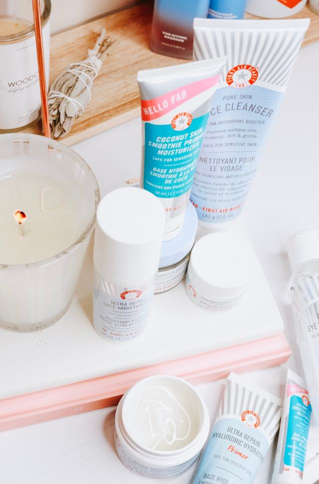 A flatlay style photo of several First Aid Beauty products. Clean beauty for sensitive skin.