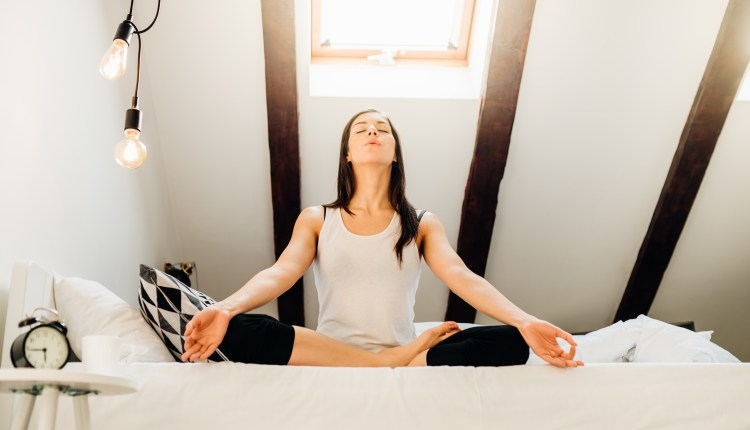 Woman Meditating In Bedroom At Home.antistress Practice.overcomi
