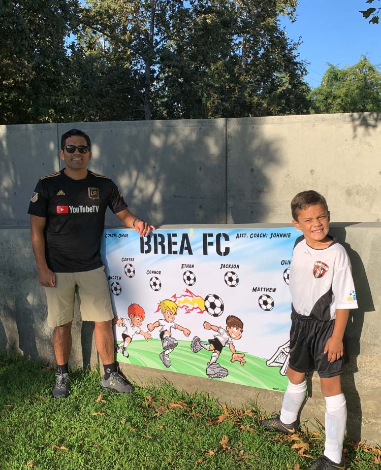 Omar Martinez with son