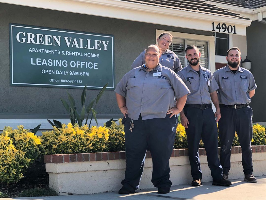 What is a grounds keeper - Green valley groundskeeper in front of leasing office