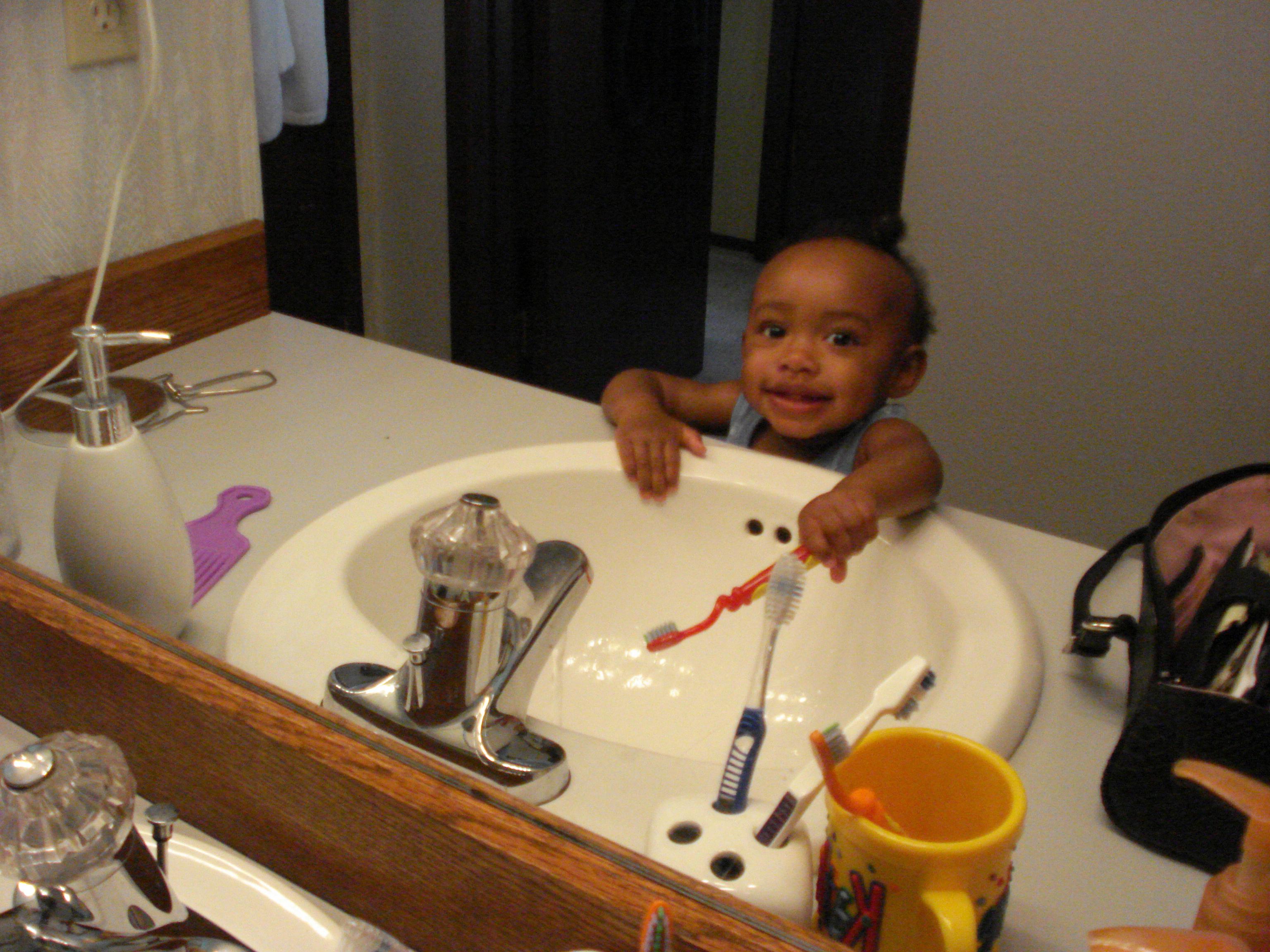 Stephanie brushing teeth
