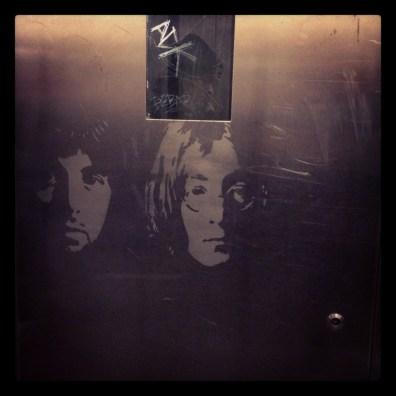 John & Paul's faces inside a Metro lift