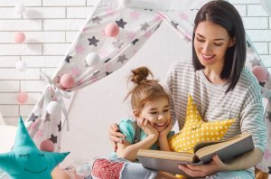 fairy tale read aloud : mom reading to her daughter
