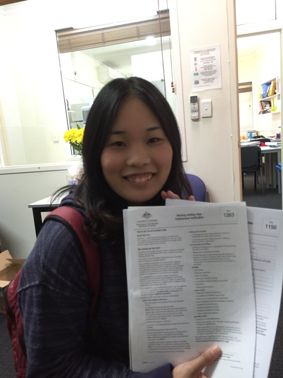 Sakura proudly shows her immigration papers for her extra year in Australia.
