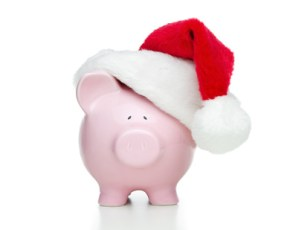 Piggy bank with christmas hat isolated on white background