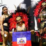 Carnival goers in front of Carnival III static billboard