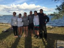 Coach Andrew with a group of high school sailors