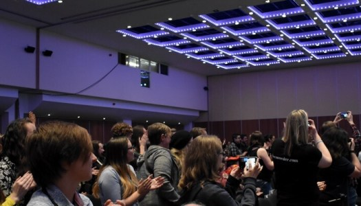 Everyone cheering for Kat at ClexaCon London. No, not my panel, but it was the same room.