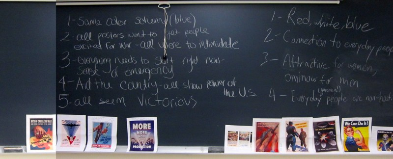 Photo of chalkboard with photocopies of WWII posters and student writing
