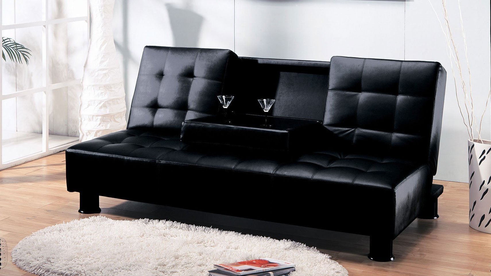 cup holder sofa bed glider ron arad monticello w futons living room
