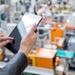 Executive Working on Tablet in Warehouse