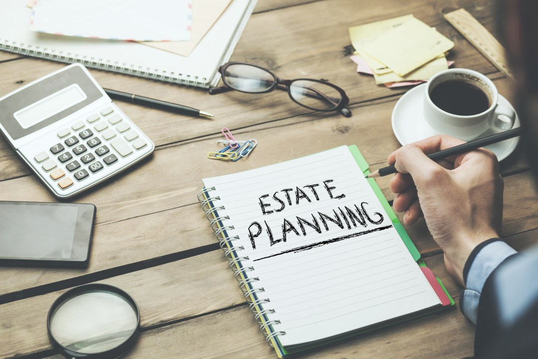 estate planning notebook with coffee