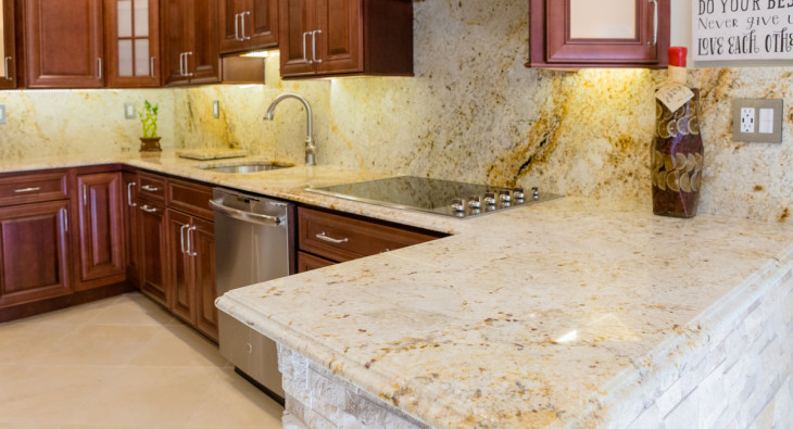 granite kitchen countertops pictures island vent how to keep your stone damage free let s get colonial gold counter top