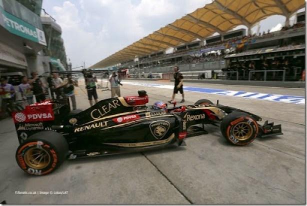 Sepang International Circuit, Sepang, Kuala Lumpur, Malaysia.Friday 28 March 2014.Romain Grosjean, Lotus E22 Renault, leaves the cockpit.Photo: Alastair Staley/Lotus F1 Team.ref: Digital Image _79P9663