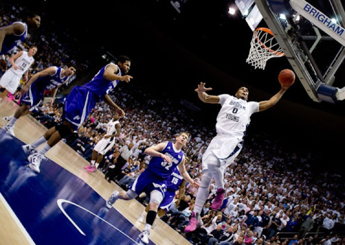 BYU forward Brandon Davies (0) dunks the ball. BYU vs. Portland, college basketball Saturday, February 25, 2012 in Provo, Utah. Photo by Trent Nelson/The Salt Lake Tribune
