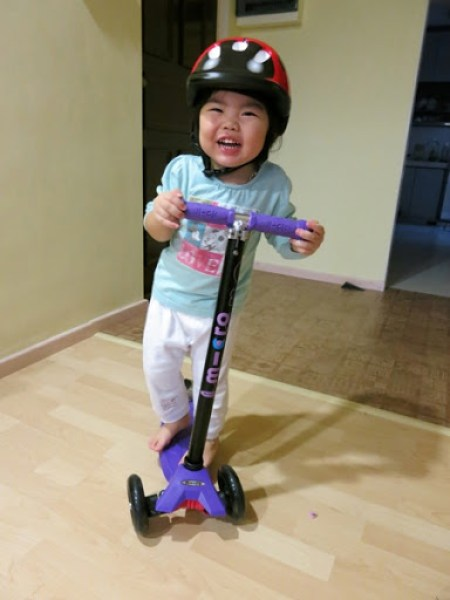 Yining On Her New Scooter Board