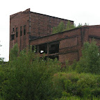 Abandoned power plant buildings high above the city.
