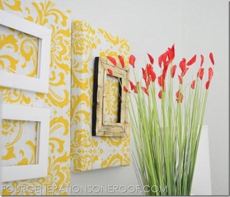 Fabric covered canvas with picture frame