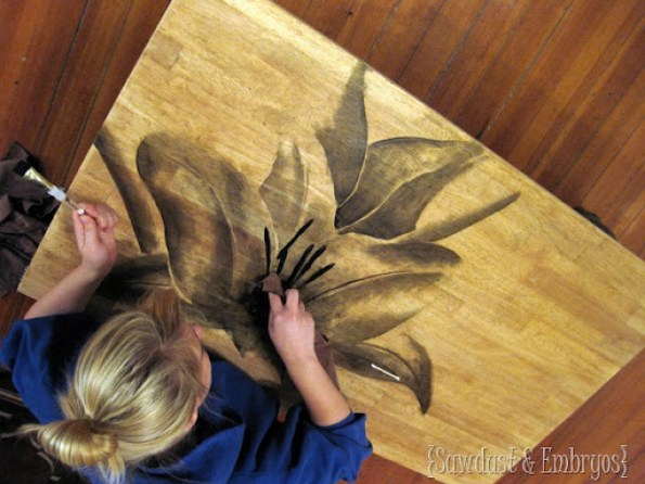 stained flower painting on a dresser