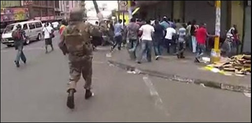SA MILITARY MEN PATROLLING DOWNTOWN JOHANNESBURG RAIDING SHOPS OF UNARMED FOREIGN TRADERS FEB 12 2012 with cops firedept VIDEO by Adrian de Kock