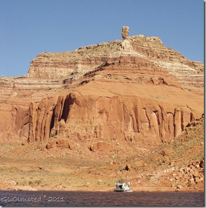 Houseboat beached below Balanced Rock Dry Rock Creek Canyon Lake Powell Utah