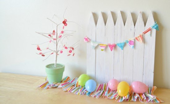 Make a mini white picket fence out of wood stakes. Use it as a centerpiece, shelf decor or a photography backdrop.