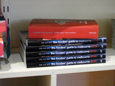 Dostoevsky's Crime and Punishment sits atop a pile of The Foodie's Guide To Melbourne 2010 - no comment