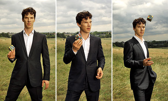 Benedict Cumberbatch in the countryside, dressed in a very smart suit, strikes 3 poses with a Rubik's cube
