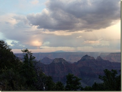 Stormy sky & rainbow above canyon 7_15pm North Rim Grand Canyon National Park Arizona