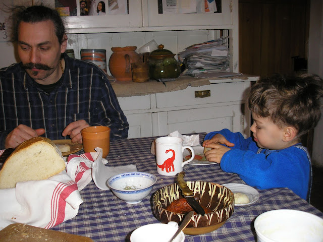 Attila and Bese having a breakfast of bread, sausage and raw onion.