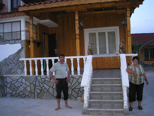 Another family of friendly gypsies who I stayed with, posing by the house theyd built.