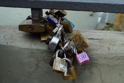 Neat little tradition! Lock it up and throw the key away, keeping your love eternal.