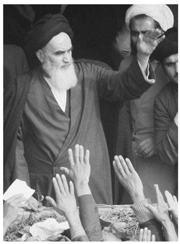 Ayatollah Khomeini (1900-1989). Ayatollah Ruhollah Khomeini (center) waves to supporters on February 1, 1979, the day of his return to Iran from exile, after the abdication of the shah.