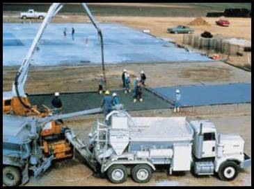 Fig. 6. Mobile batcher measures materials by volume and continuously mixes concrete as the dry ingredients, water, and admixtures are fed into a mixing trough at the rear of the vehicle.