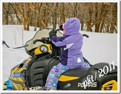 P1010035Kaylin-on-snowmobile