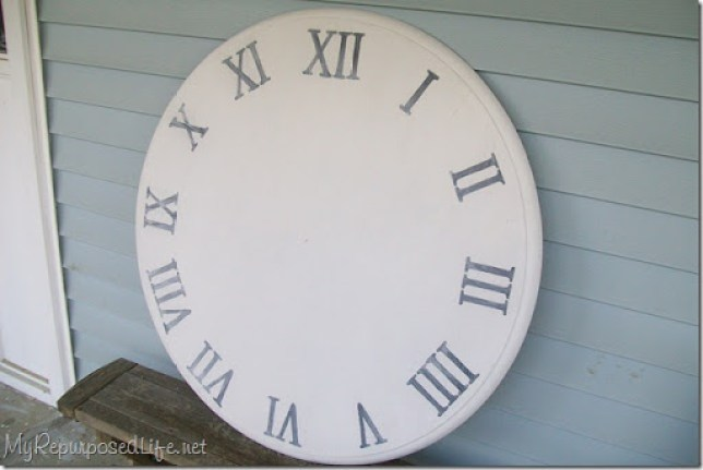 large stenciled clock using an old kitchen table top