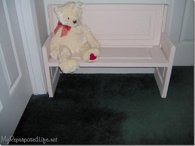 door repurposed into bench for kids (dolls)