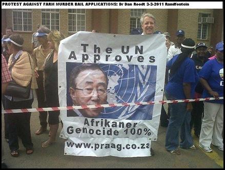 ROODT DR DAN PRAAG protesting against farm murderers bail application RANDFONTEIN MARCH 13 2011 huge placard