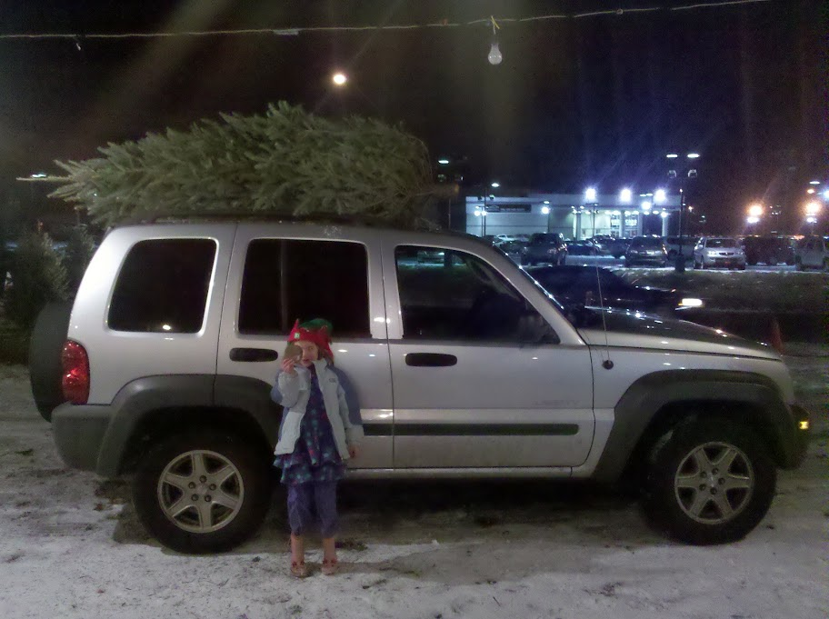 Sophia and the tree on the Jeep