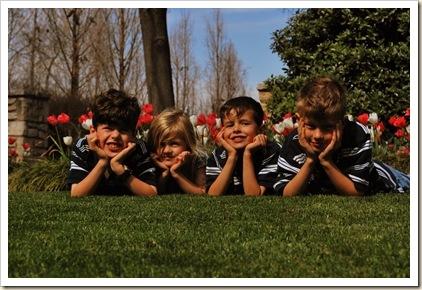 4 sweet kids in grass