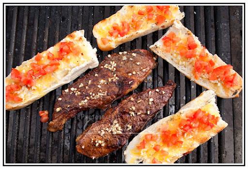 Steak and Garlic Bread on the Grill under Gerads careful watch