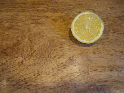 Sunny lemon on a cutting board
