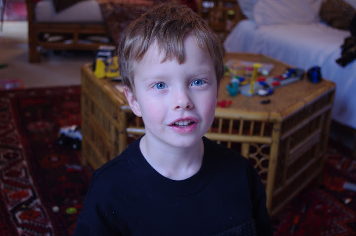 Beautiful blue eyes. He's probably asking if he can have more candy/screens/presents.