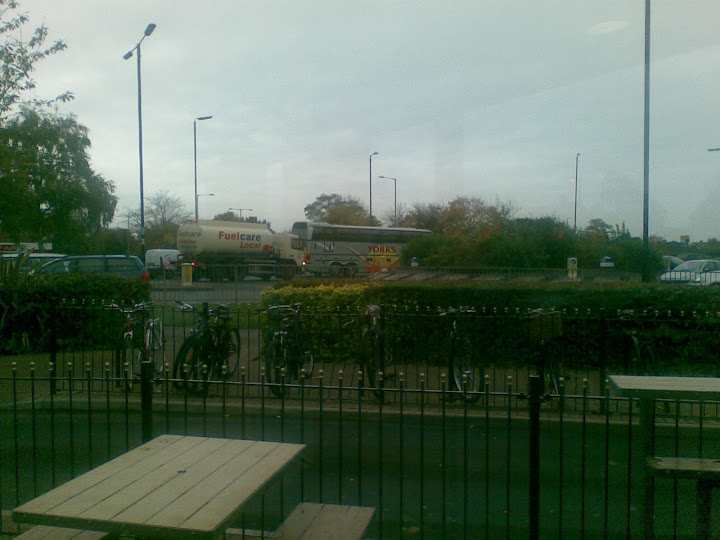 The club coach is spotted from a pub garden.