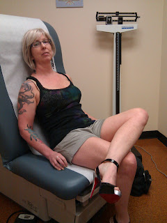 Waiting for some medical attention.  In Louboutons.
