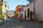 Nadia successful at hitting a Piniata on a cobblestone street of Colonia San Rafael in San Miguel de Allende, Mexico.