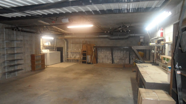 Spacious 2-car garage with laundry room and storage space in the back.