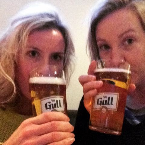 Katie and Kate drinking Gull beer on Iceland food and drink