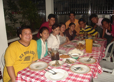 March 21: Students dine a sumptuous supper courtesy of Lucky's family.